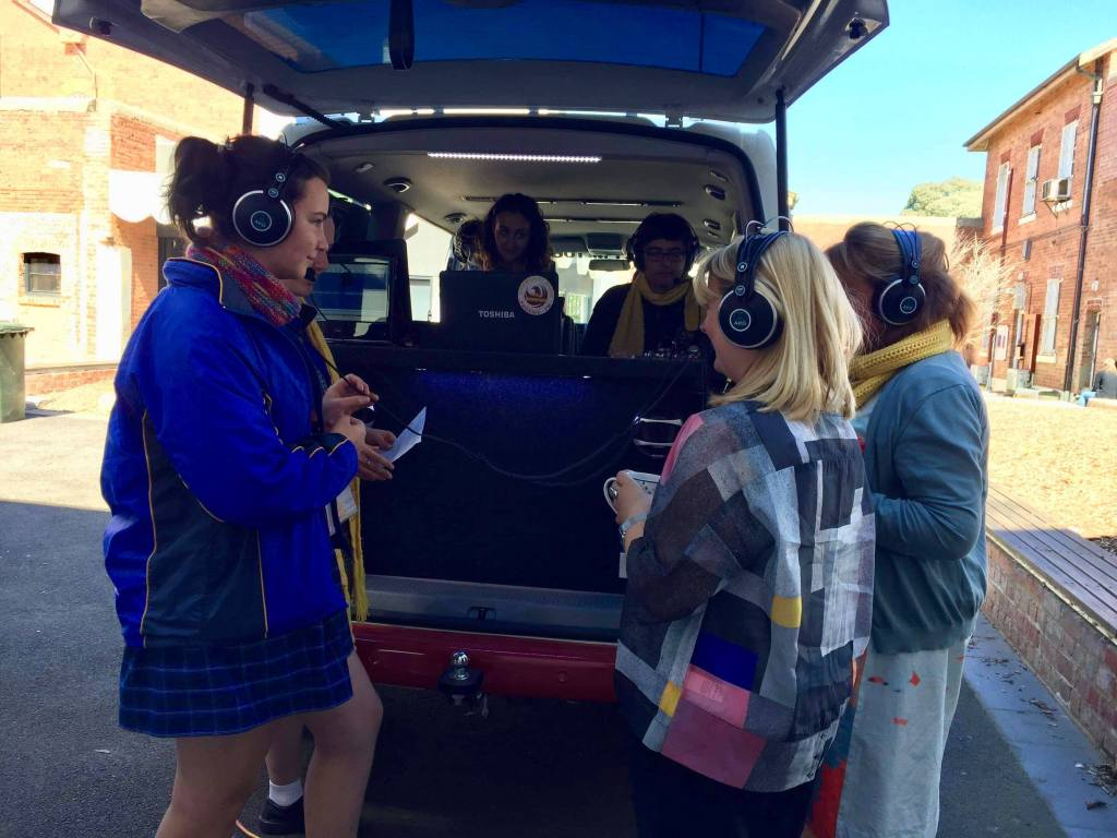 [Pictured]: Some students interviewing talent at the Bendigo Artlands Festival. Erin is shadowing a student while operating the OB van.